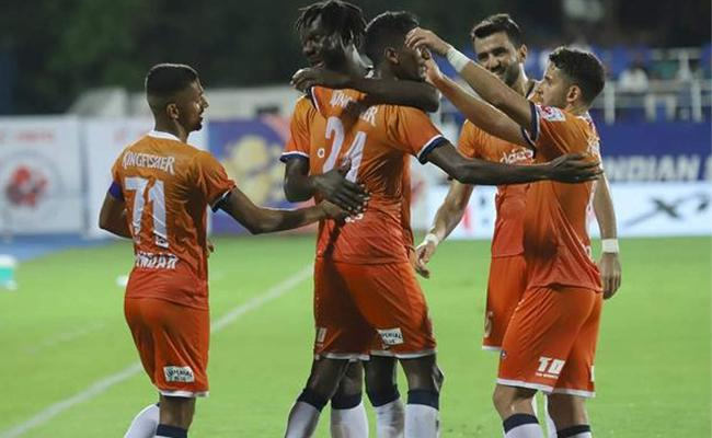 FC Goa win goal-fest against Mumbai City in ISL - Sakshi