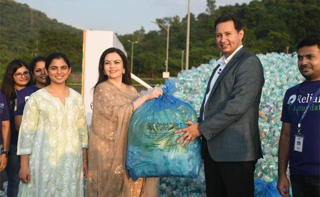 Reliance employees give new life to waste plastic bottles - Sakshi