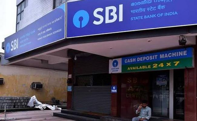 SBI cuts lending rates by 5 basis points reduces interest on fixed deposits - Sakshi