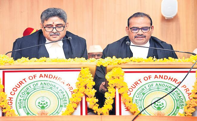 Justice Rakesh Kumar sworn in as High Court judge - Sakshi