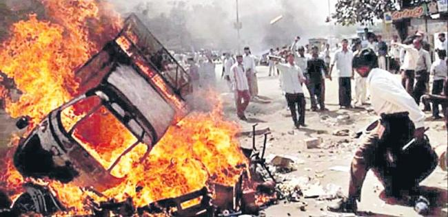 Nanavati panel gives clean chit to then CM Modi in Gujarat riots - Sakshi