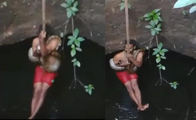 Viral Video: Kerala Man Falls Into Well With Snake While Rescuing It - Sakshi