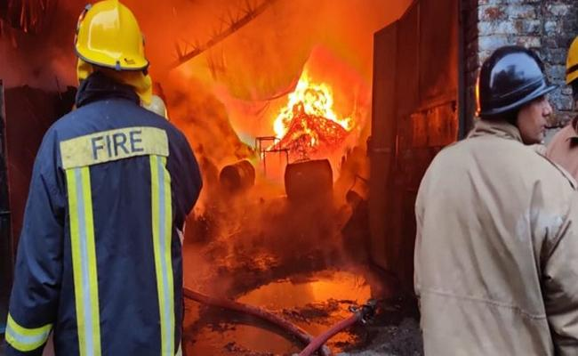 Fire in plywood factory at Delhi Mundka - Sakshi