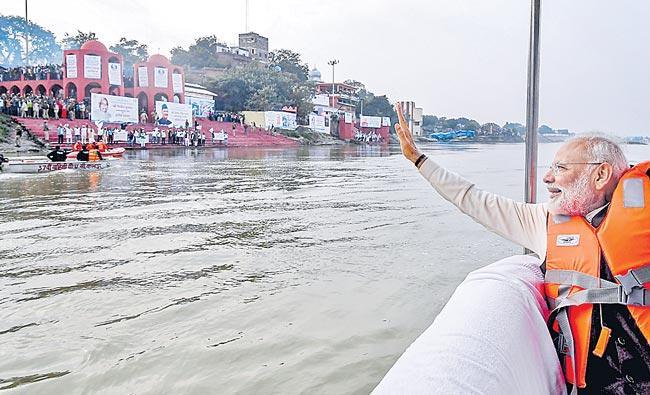 PM Narendra Modi chairs meeting of Ganga council in Kanpur - Sakshi