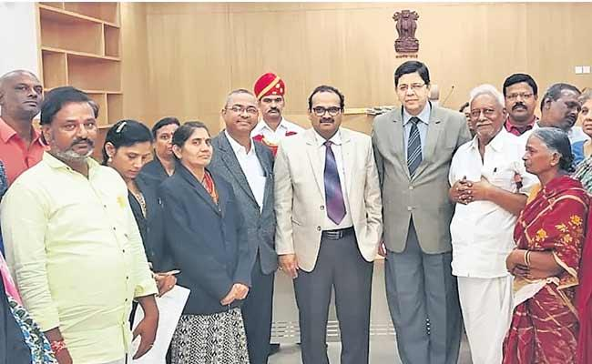 Over 18000 cases settled in Lok Adalat - Sakshi