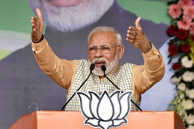 Congress raising storm over Citizenship Law - Sakshi