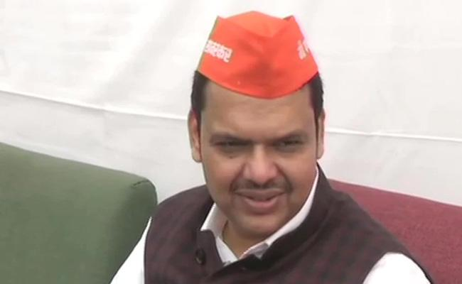 BJP Leaders Wear I Am Savarkar Caps In Maharashtra Assembly - Sakshi