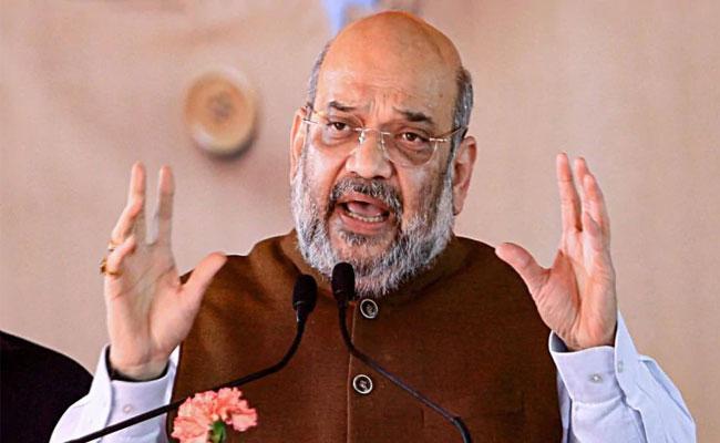Amit Shah Sets 2024 Is Nation Wide NRC Deadline - Sakshi