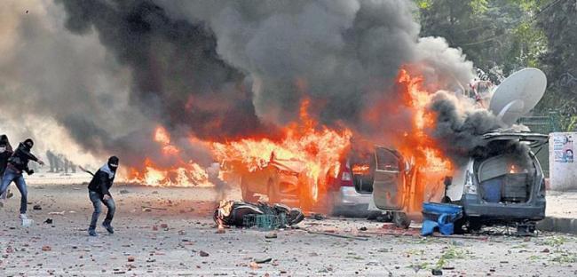 Violent protests against Citizenship Amendment Act - Sakshi