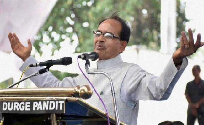 PM Modi Is Like God To Migrants Says Shivraj Singh Chouhan - Sakshi