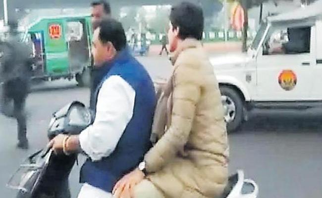 Penalty For Former IPS O Darapuri Not Helmet With Priyanka Gandhi - Sakshi