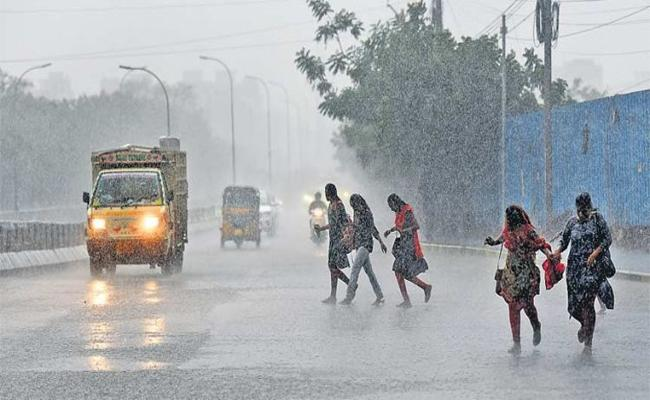 Moderate rains in Telangana State - Sakshi