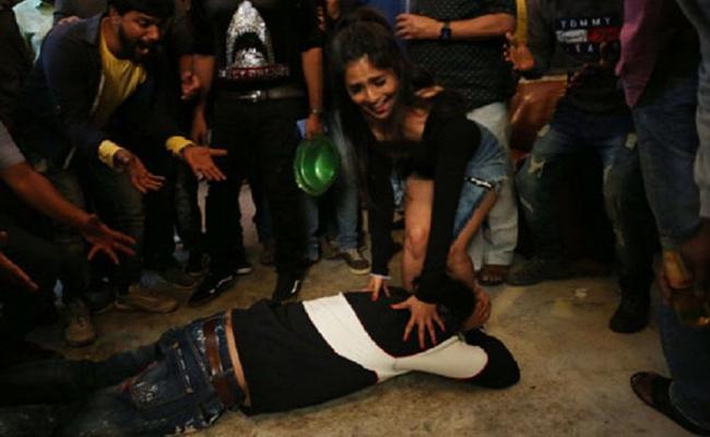 Ram Gopal Varma Touches Heroine Naina Ganguly Feet - Sakshi