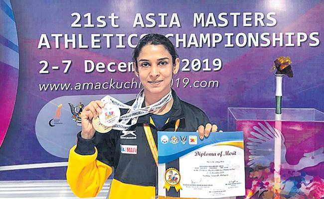 Athlet Divya Reddy Wins Another Gold Medal In Asia Masters Championship - Sakshi