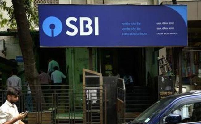 SBI Cuts Mclr rate10bps point - Sakshi