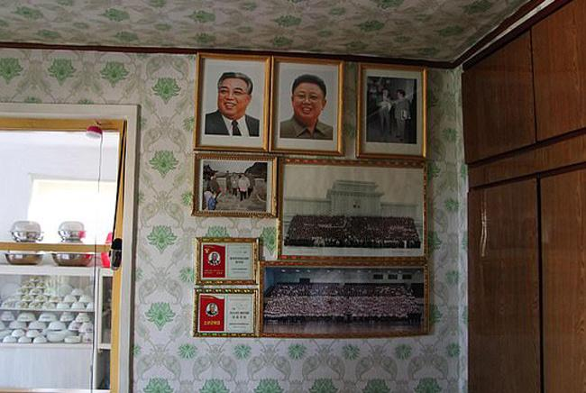 North Korean mother faces prison for Failed to Rescue Portrait of Kim Jong-il - Sakshi