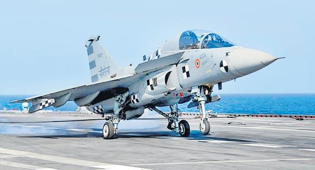 Light Combat Aircraft lands on INS Vikramaditya - Sakshi