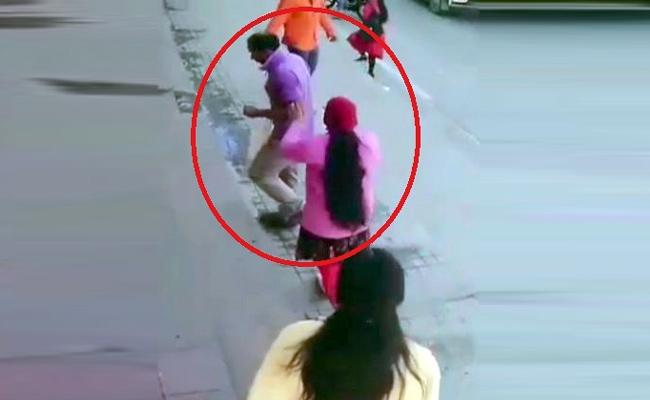 Wife Beating Husband on Road in Bangalore Viral in Social Media - Sakshi