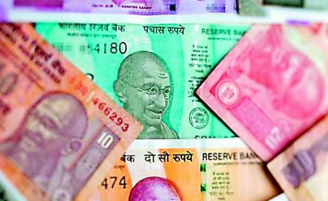 Rupee falls 14 paise, slips below 71 per US dollar - Sakshi