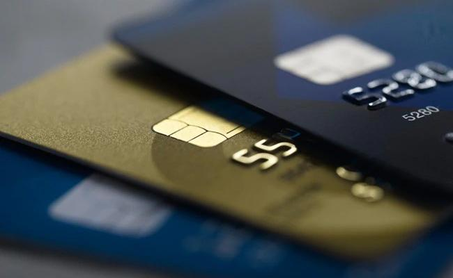 RBI allows users to enable disable credit debit cards modify usage limit - Sakshi