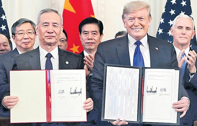 Donald Trump, China's Liu He sign first phase of new trade deal - Sakshi