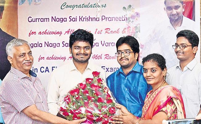 Krishna Praneeth As All india First Rank Topper In CA - Sakshi