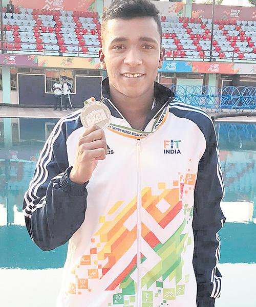 AP Swimmer Lohit Wins Silver Medal In Indian Youth Games - Sakshi