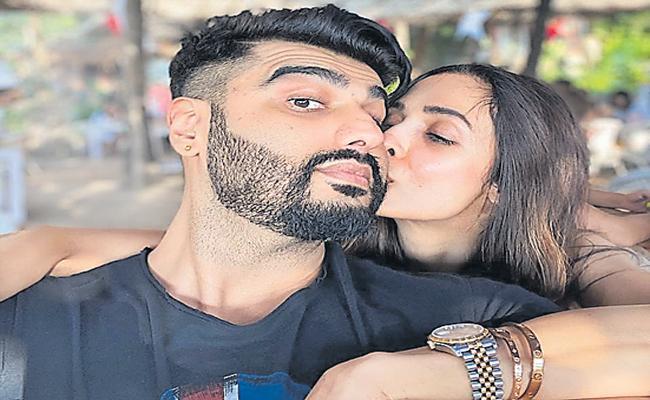 Malaika Arora shared a photo of her kissing with Arjun Kapoor - Sakshi