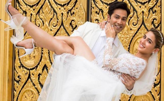 Varun Dhawan Looks Likes Marries Sara Ali Khan In Coolie No 1 Latest Poster - Sakshi