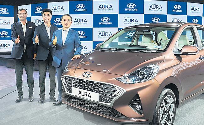 Hyundai Launches Compact Sedan Aura - Sakshi