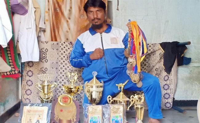 Person Giving Free Karate Training For Poor People  - Sakshi
