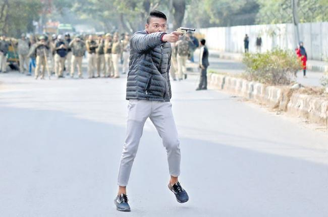 Protests in Delhi after man fires at students rally - Sakshi
