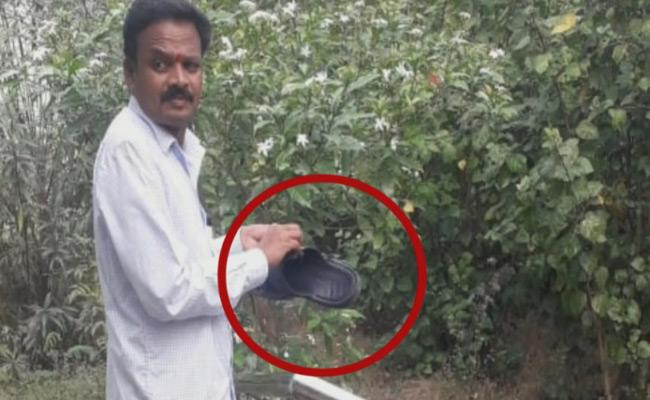 DMHO Cleans His Chappals With Attender In Sircilla District - Sakshi