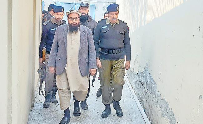 Pakistan court sentences Hafiz Saeed to 11 years  - Sakshi