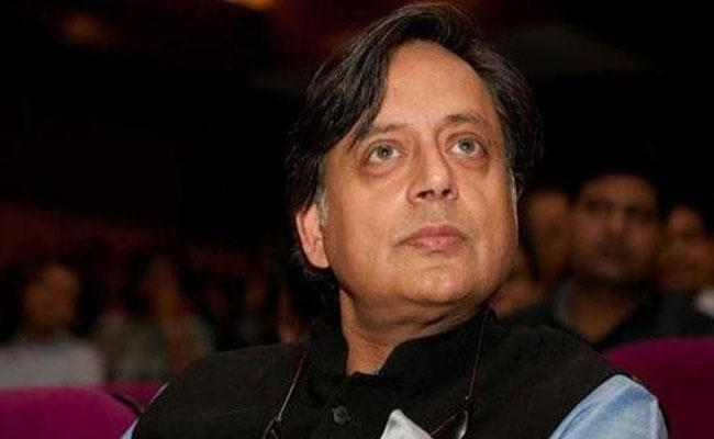 Tharoor fined Rs 5000 by Delhi court - Sakshi
