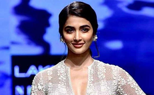 Pooja Hegde Says Try Something New In Life It Will Make Us Different - Sakshi