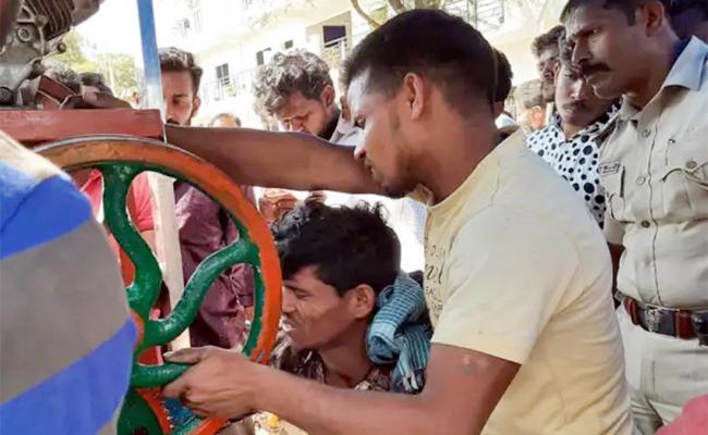 Worker Hand Stuck in Sugarcane Machine in Karnataka - Sakshi