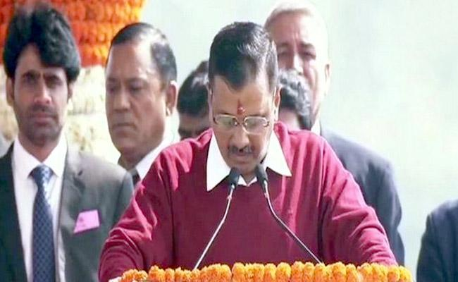 Arvind Kejriwal Takes Oath As Delhi CM - Sakshi