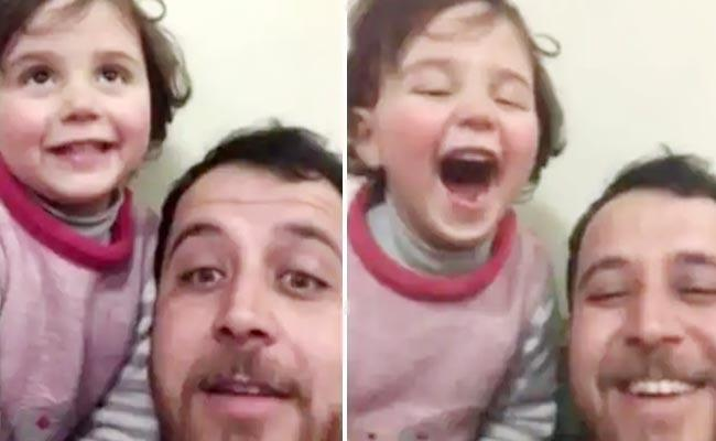 Syrian Man Teaches Daughter To Laugh At Explosions Melts Heart - Sakshi