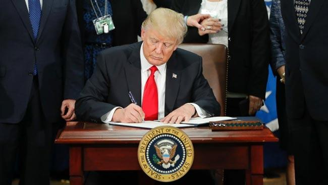 Donald Trump is Travel ban expanded to six new countries - Sakshi