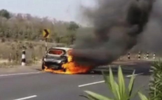 Car Met With Fire Accident Near Neradigonda Toll Gate - Sakshi
