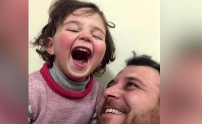 Syrian Father Daughter Laughs Over Bomb Explosion Emotional Video - Sakshi