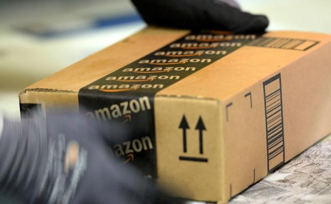 Person Cheated Amazon Company By Returning Fake Items In Online - Sakshi
