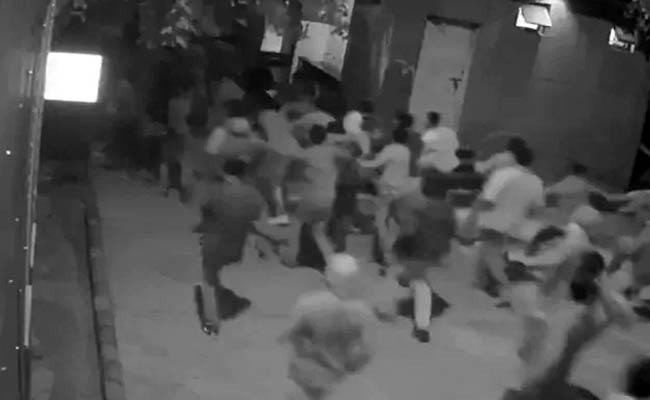 Jamia Millia Islamia University: New CCTV clips show protesters pelting stones - Sakshi