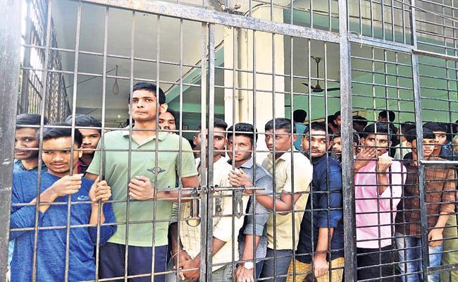 Violence In the TDP MLA Vasupalli Ganesh College - Sakshi