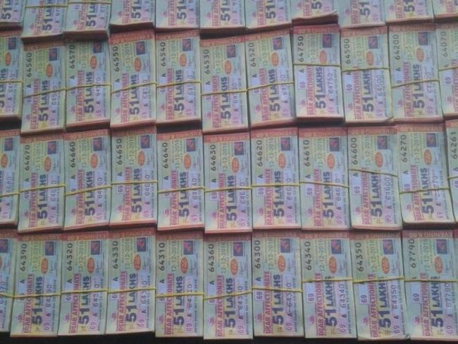 Lotteries To Attract New GST Rate From March - Sakshi