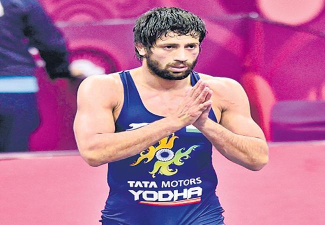 Ravi Got Gold Medals In Asian Wrestling Championship - Sakshi