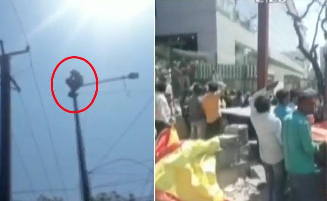 Drunk Man Climbed Electricity Pole Creates Fuss In Secunderabad - Sakshi