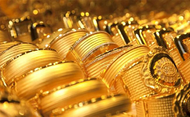Gold ends nearly 2persant higher as coronavirus fears - Sakshi
