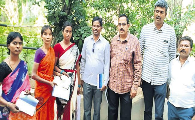 Distribution of checks to suicidal farmer families - Sakshi